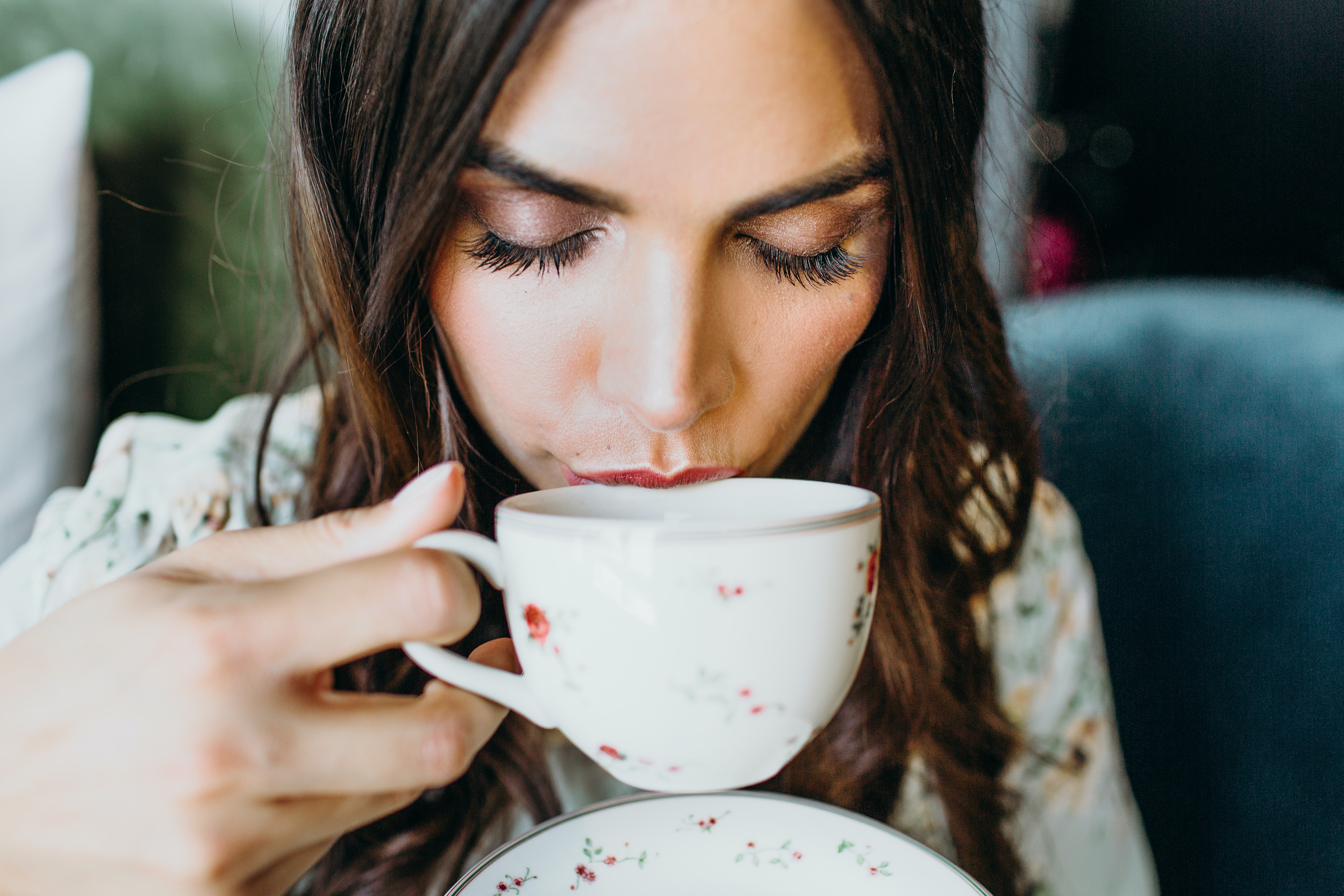 woman drinking using teacup