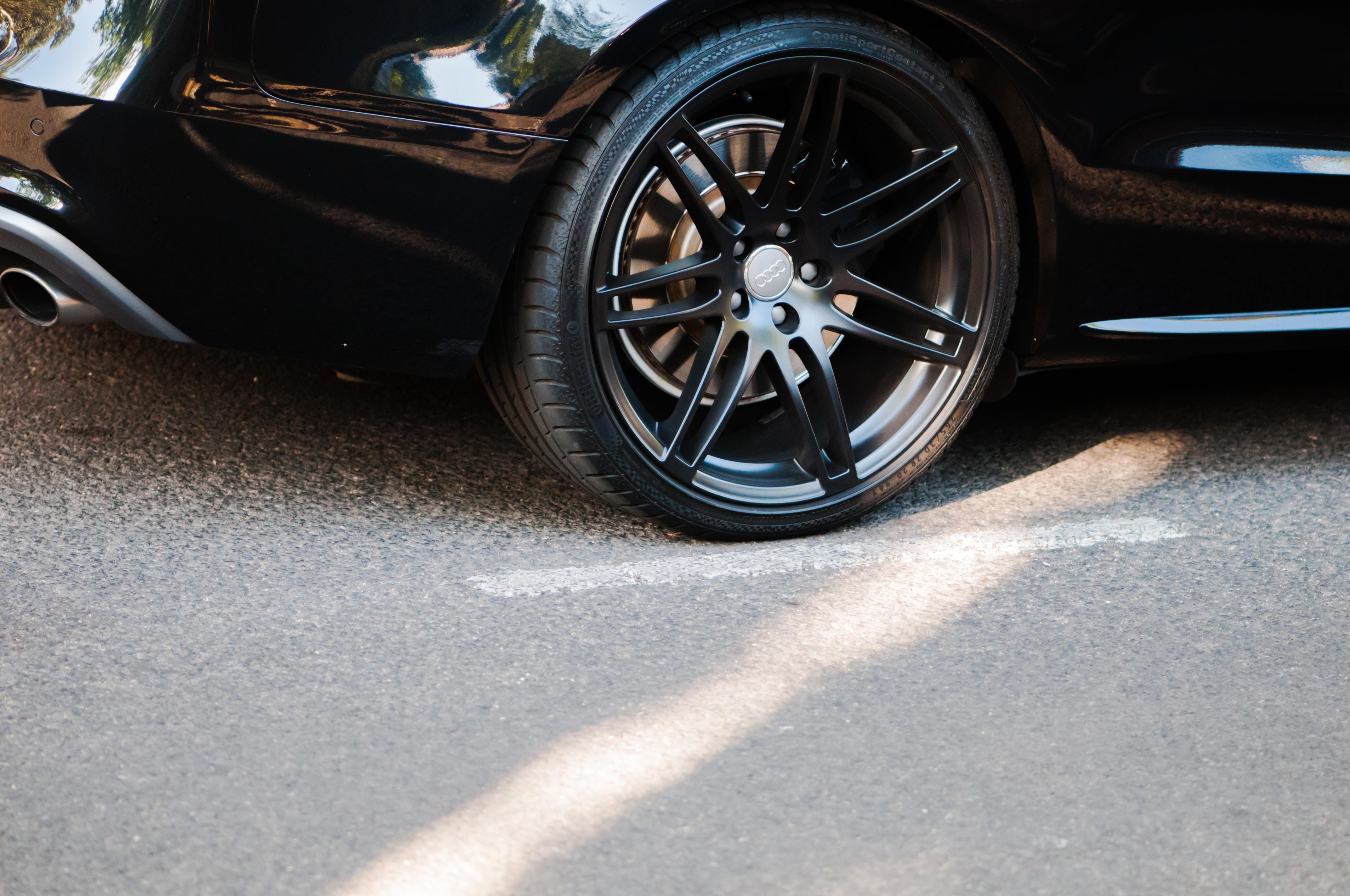 black multi-spoke vehicle wheel