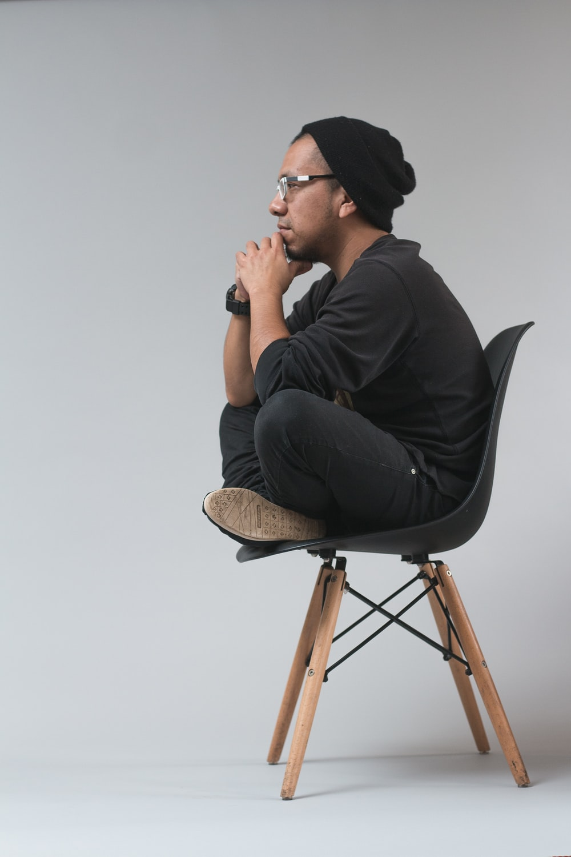 man sitting on chair