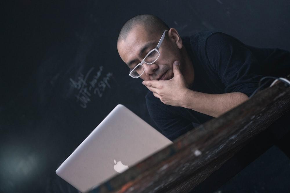 man using silver MacBook