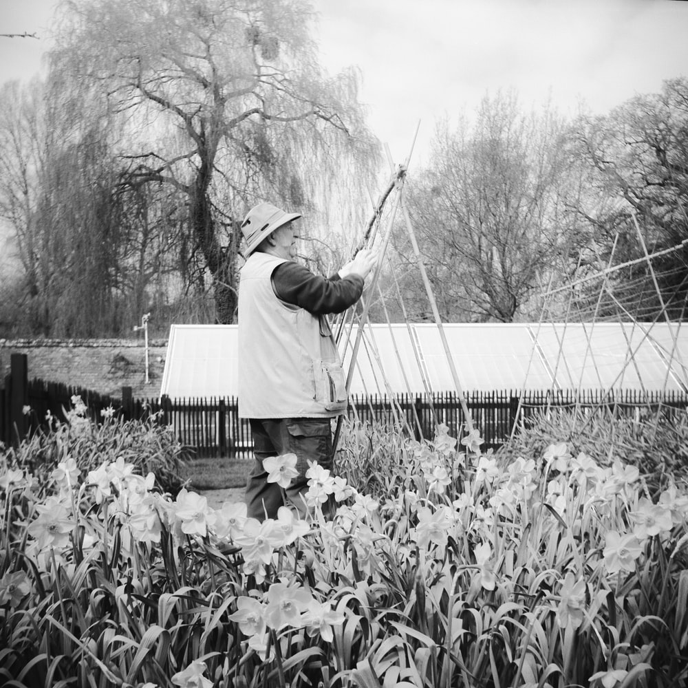 man holding fishing rod on the bridge