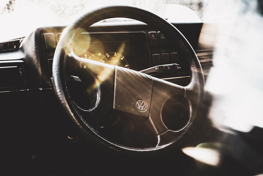 black Volkswagen steering wheel