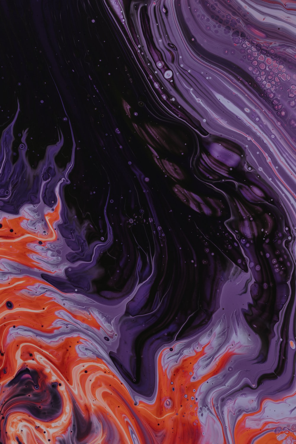 purple, black, and orange abstract paintin