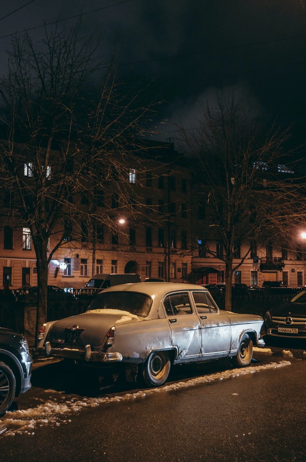 gray sedan outdoor during night time
