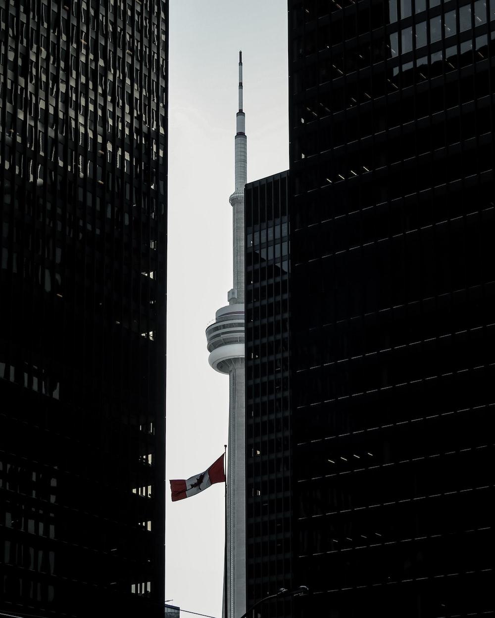 gray tower between buildings