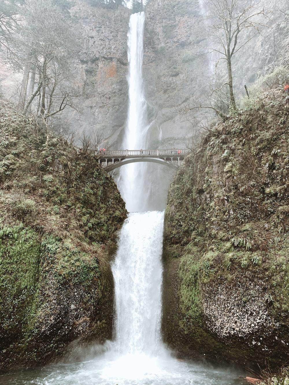 time lapse photography of waterfalls under bridge
