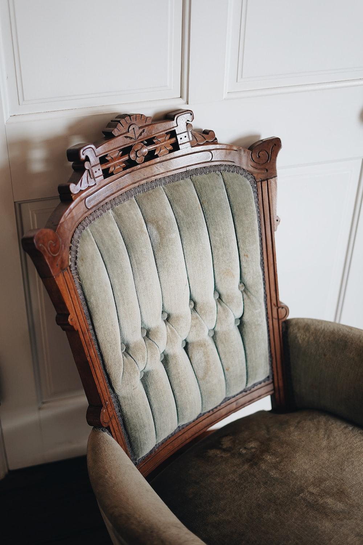 tufted brown sofa chair