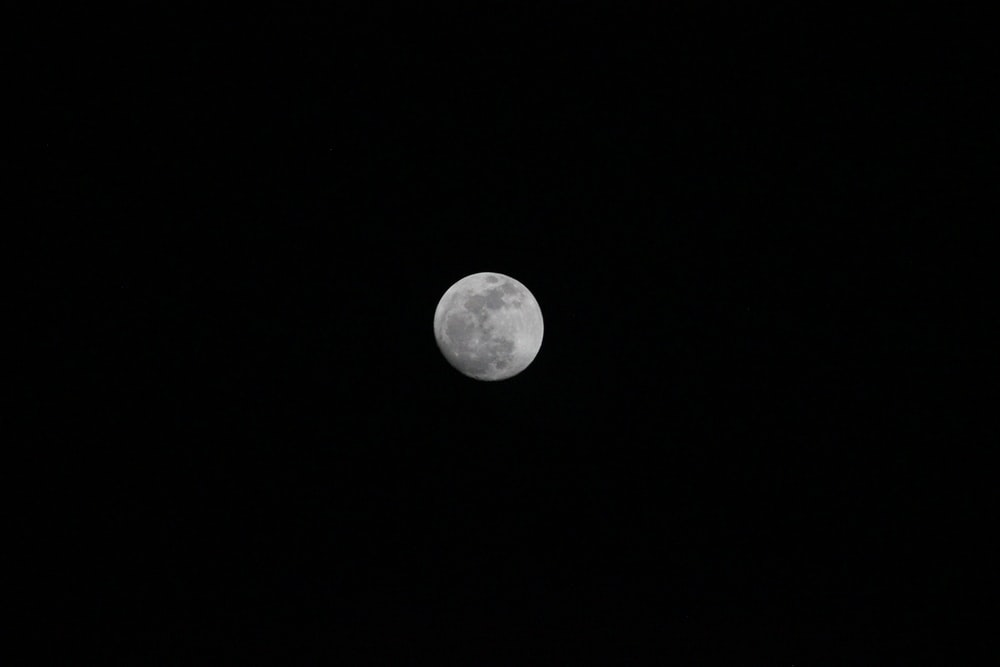 grayscale photography of full moon
