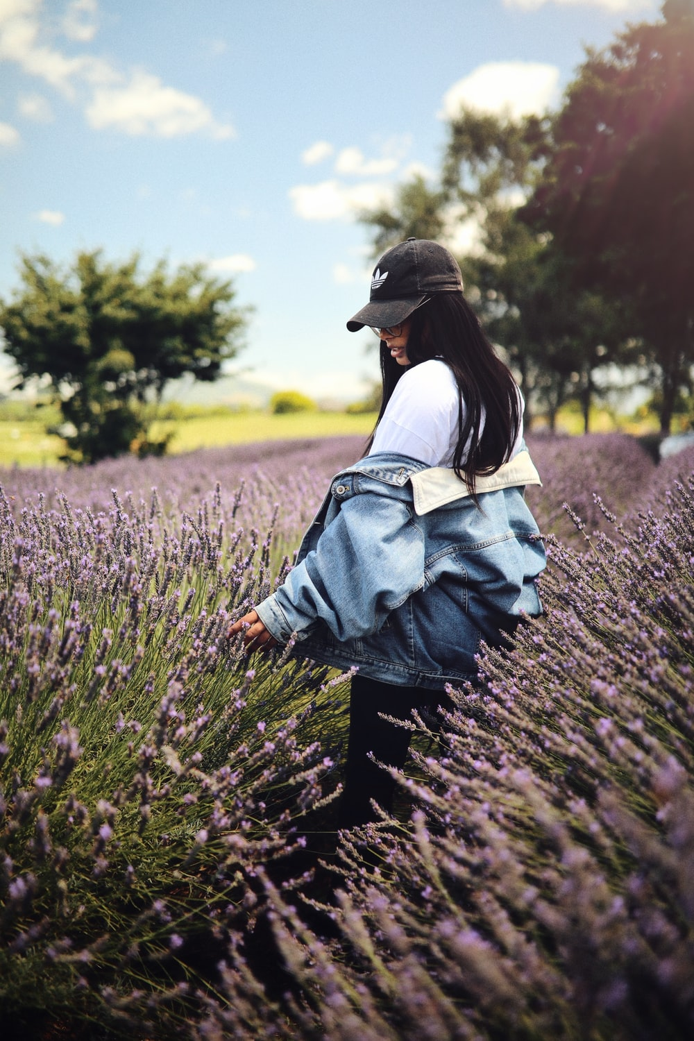 woman standing on purple flower field during daytime