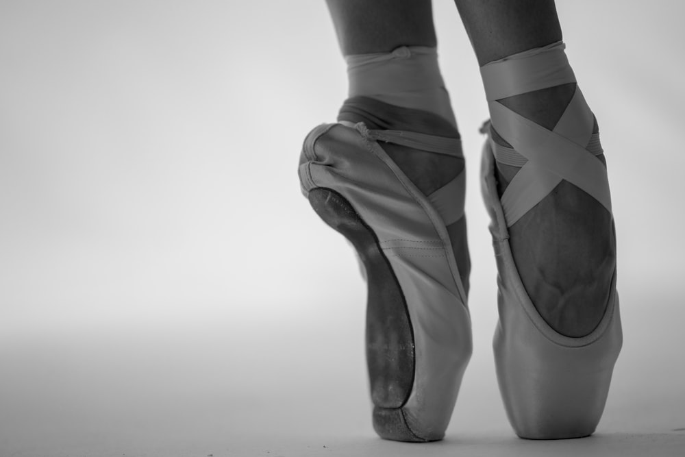 person in ballet shoes