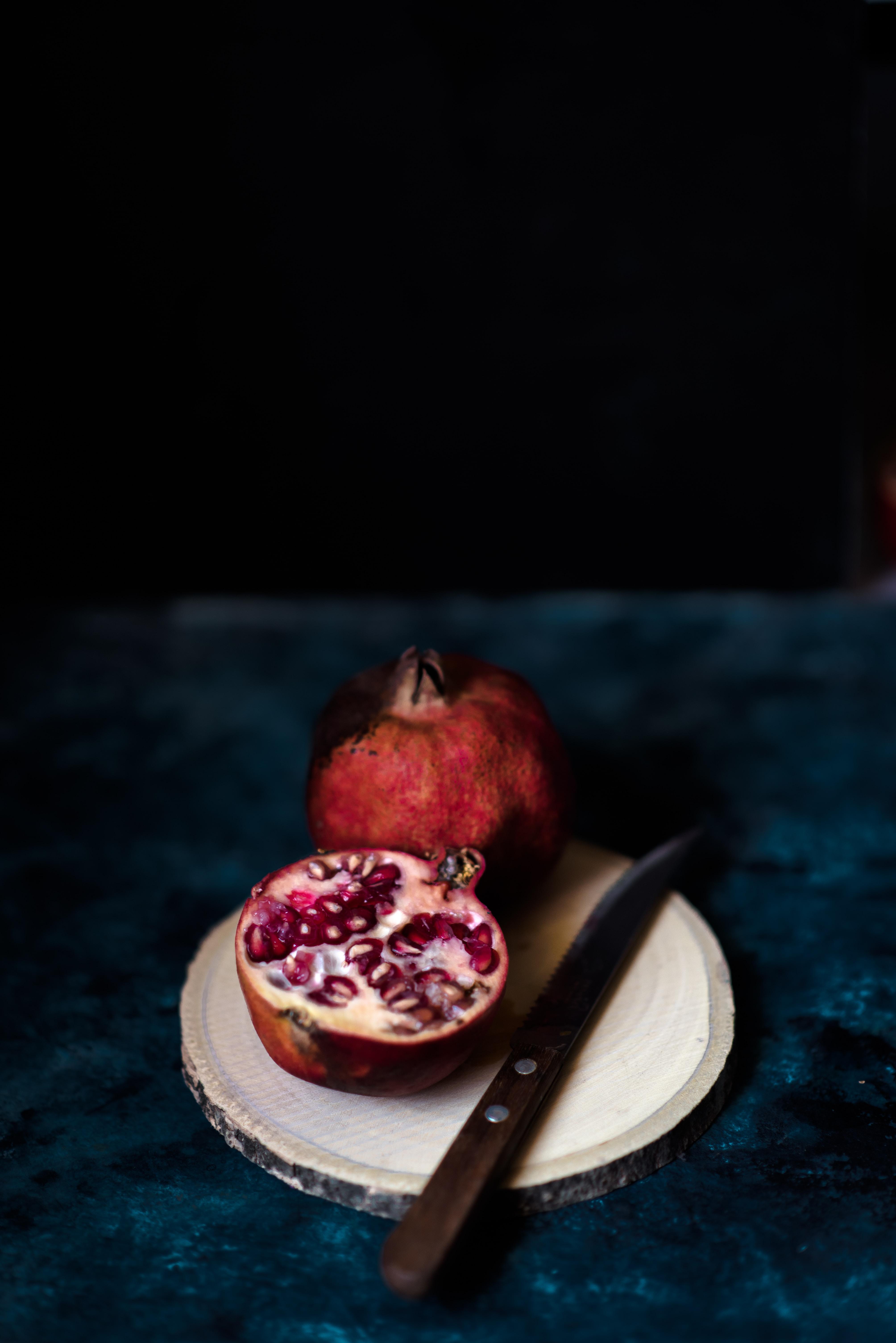 pomegranate on white saucer
