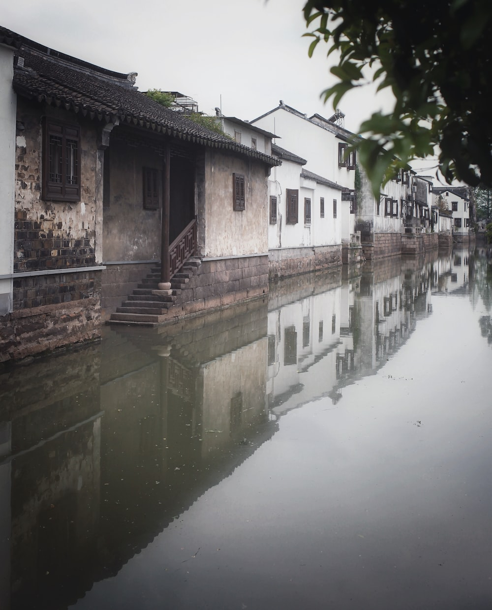 flooded white and brown concrete houses during daytime