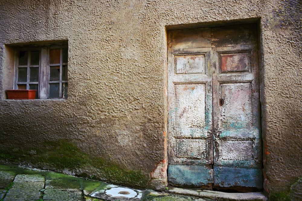 blue door near brown wall