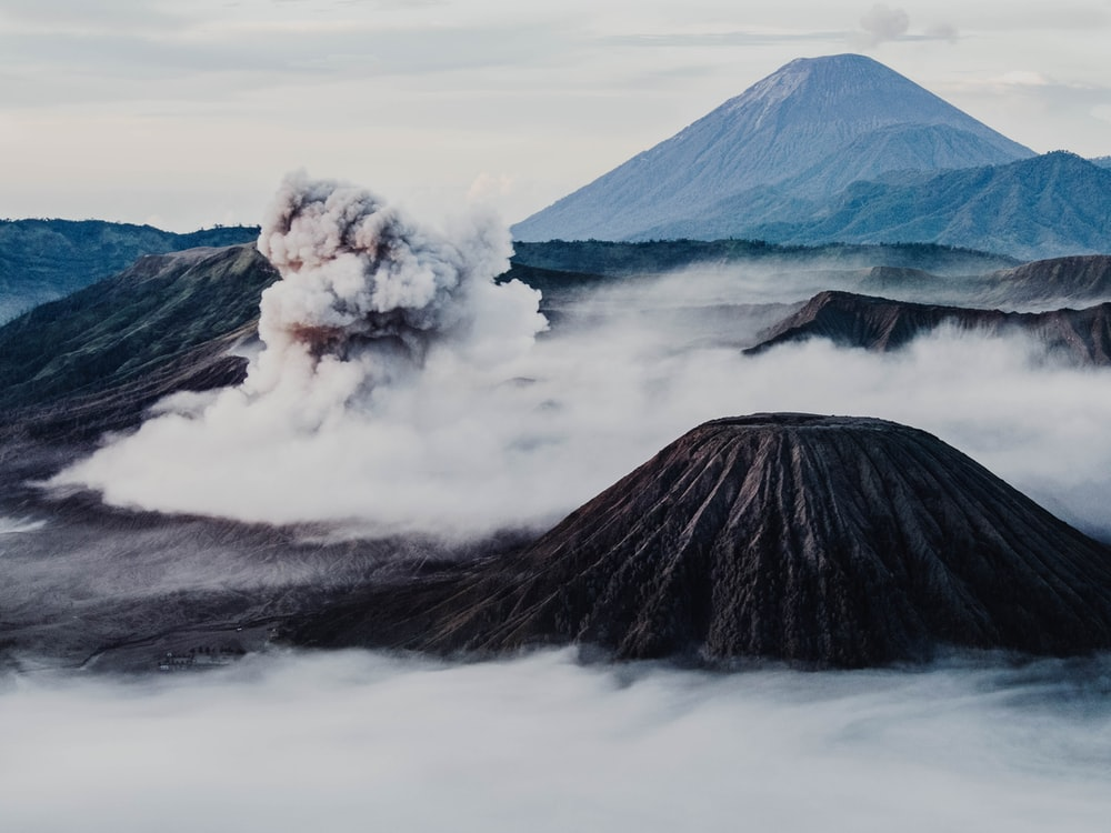 aerial view photography of volcano covered with fog