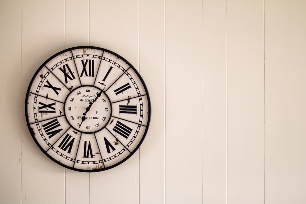 analog wall clock on wall
