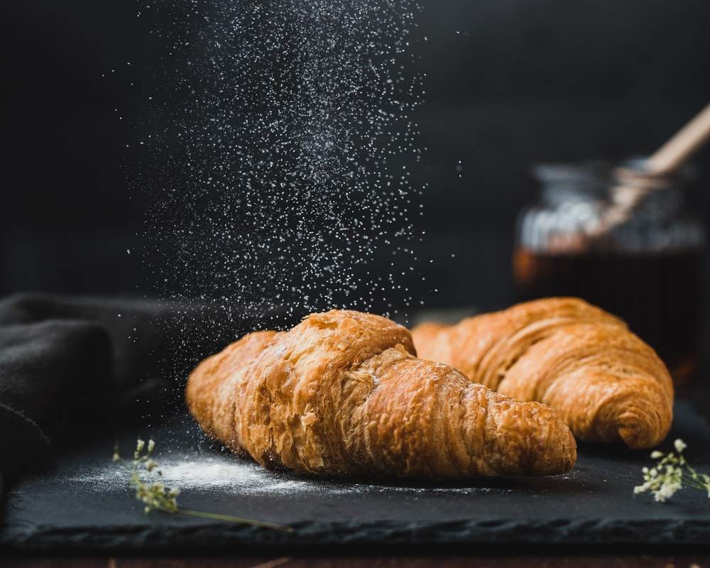 two brown croissants