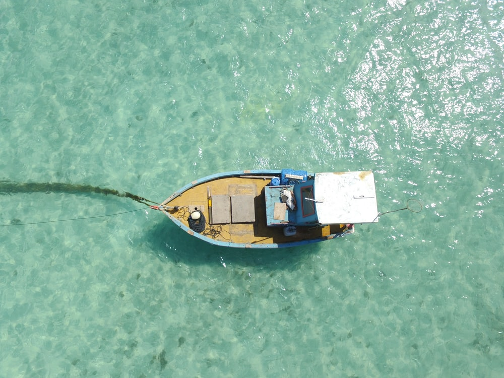 aerial photography blue-and-brown boat on water