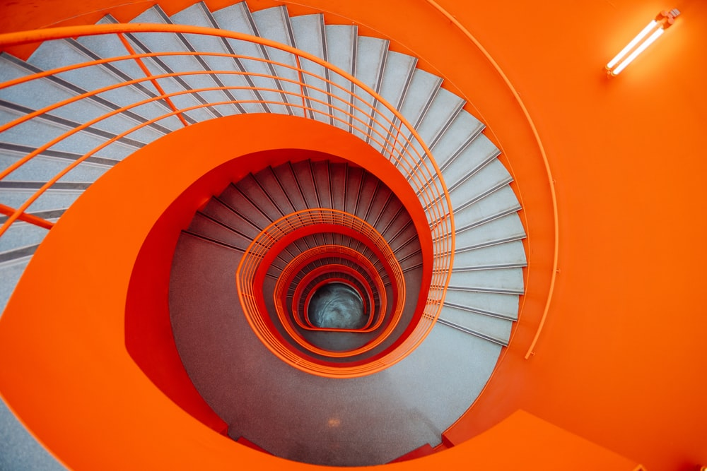 gray and orange spiral stairs