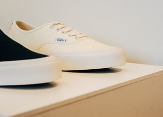 two unpaired black and white low-top shoes