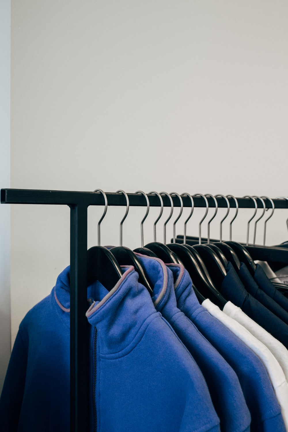 assorted-color shirt on rack