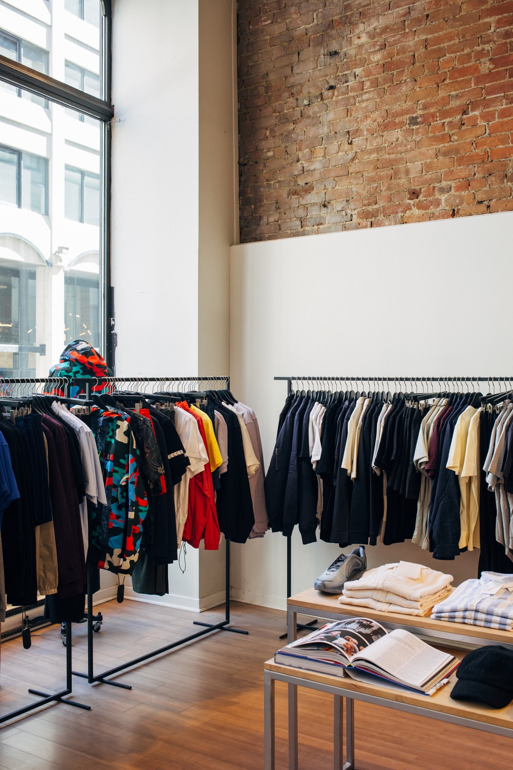 assorted-color clothes hanging on metal racks