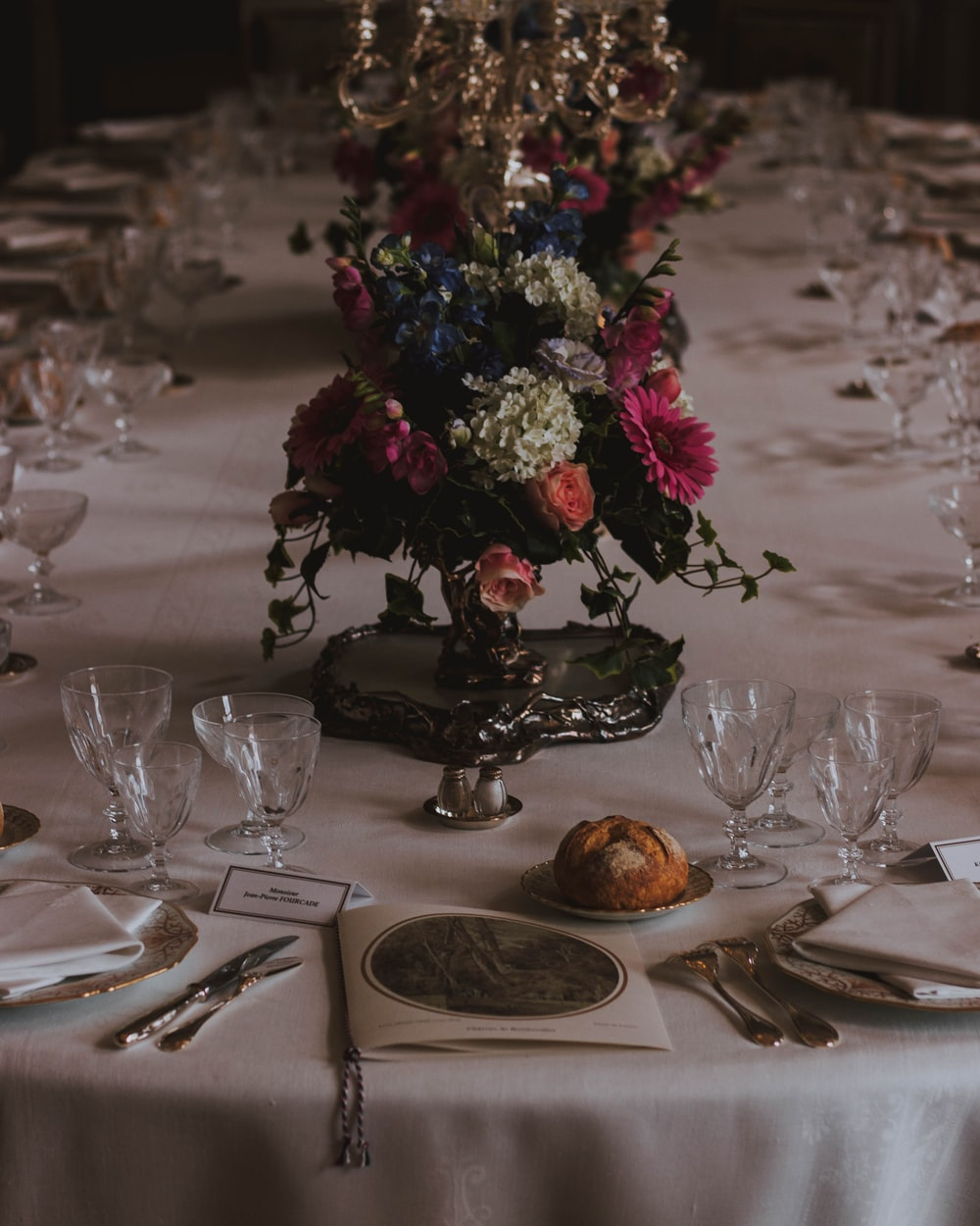 wine glasses on table with flower arrangement