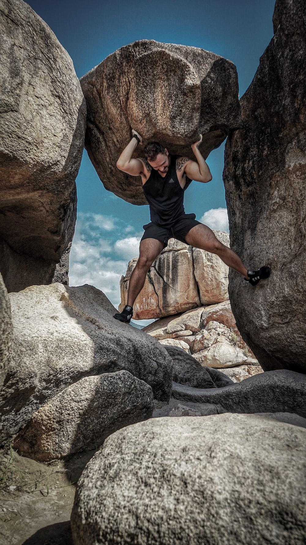 man carrying rock