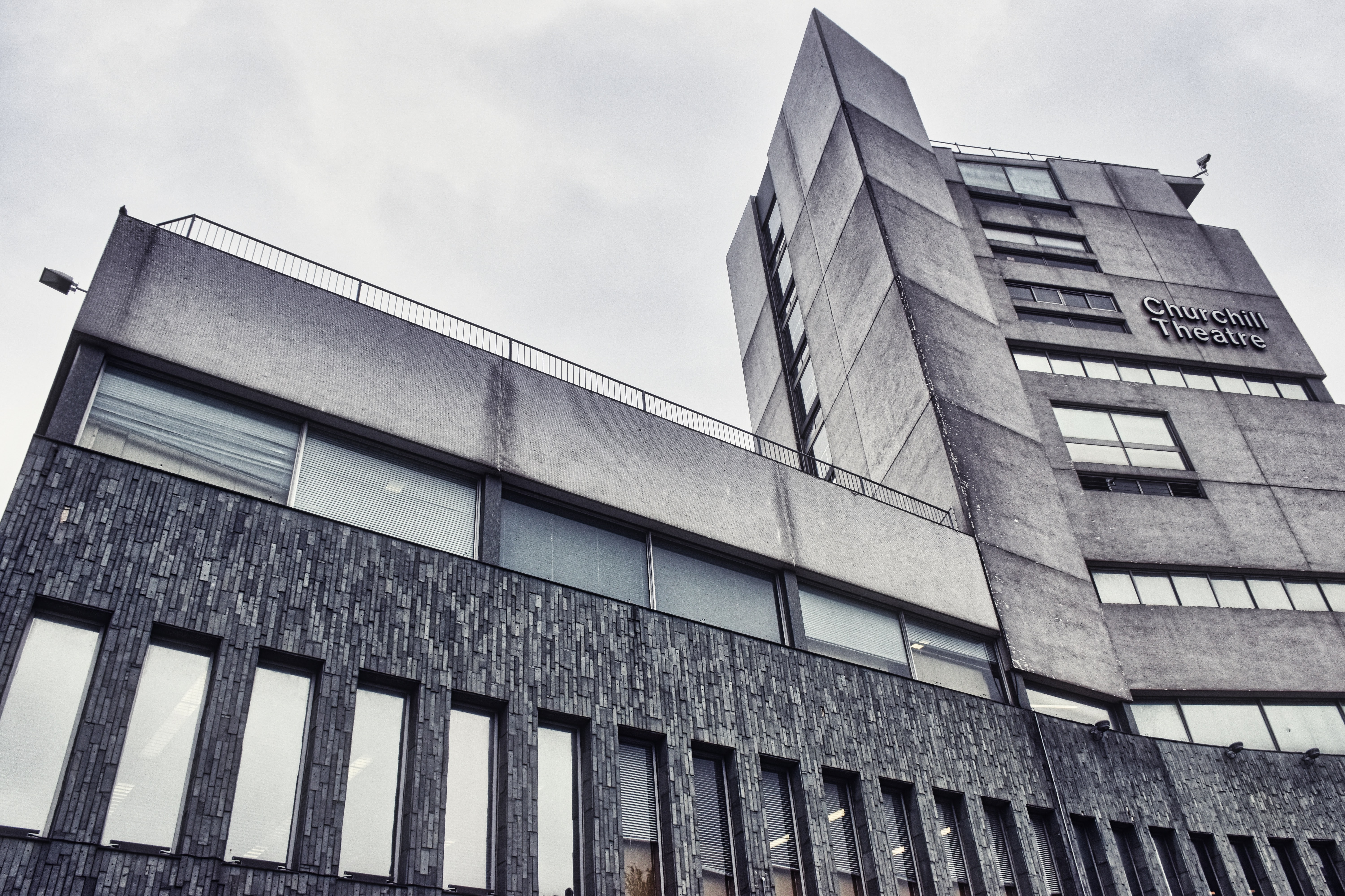 low angle photography of gray concrete building during daytime