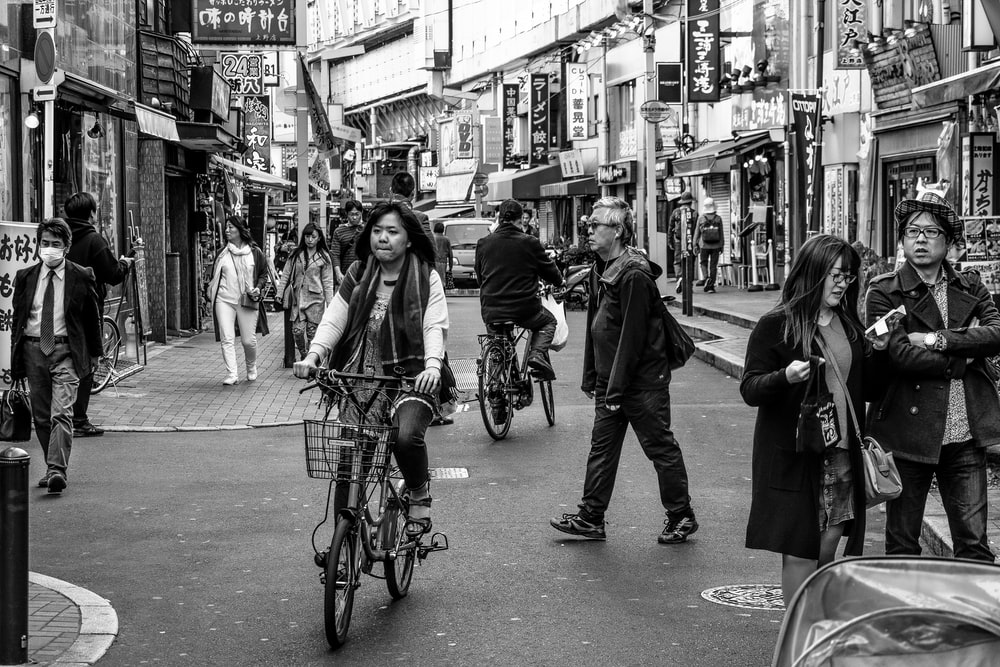 greyscale photo of people on stree