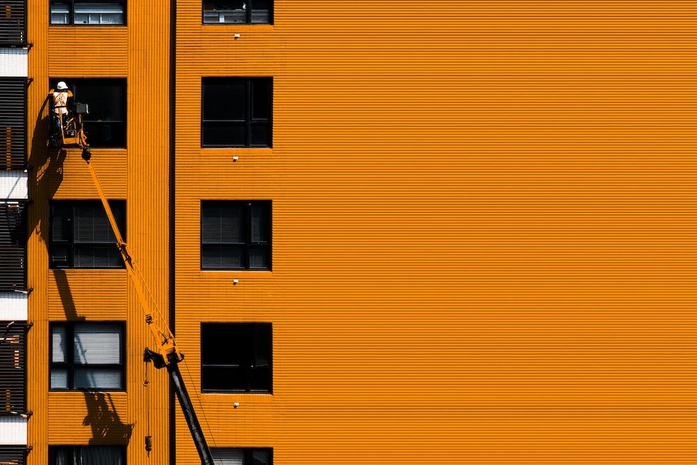 man on building window