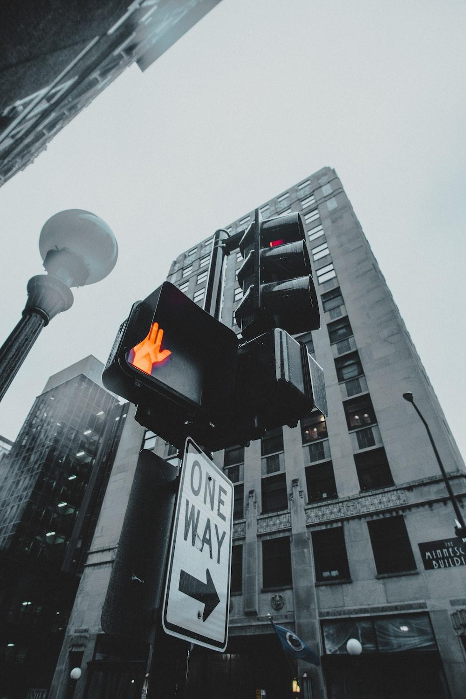 traffic light on stop beside lamp post