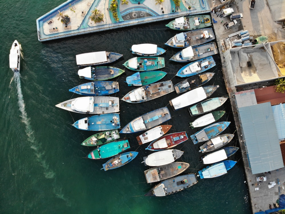aerial photography of boats on dock during daytime