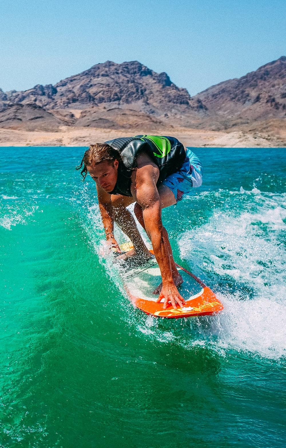 man surfing during daytime