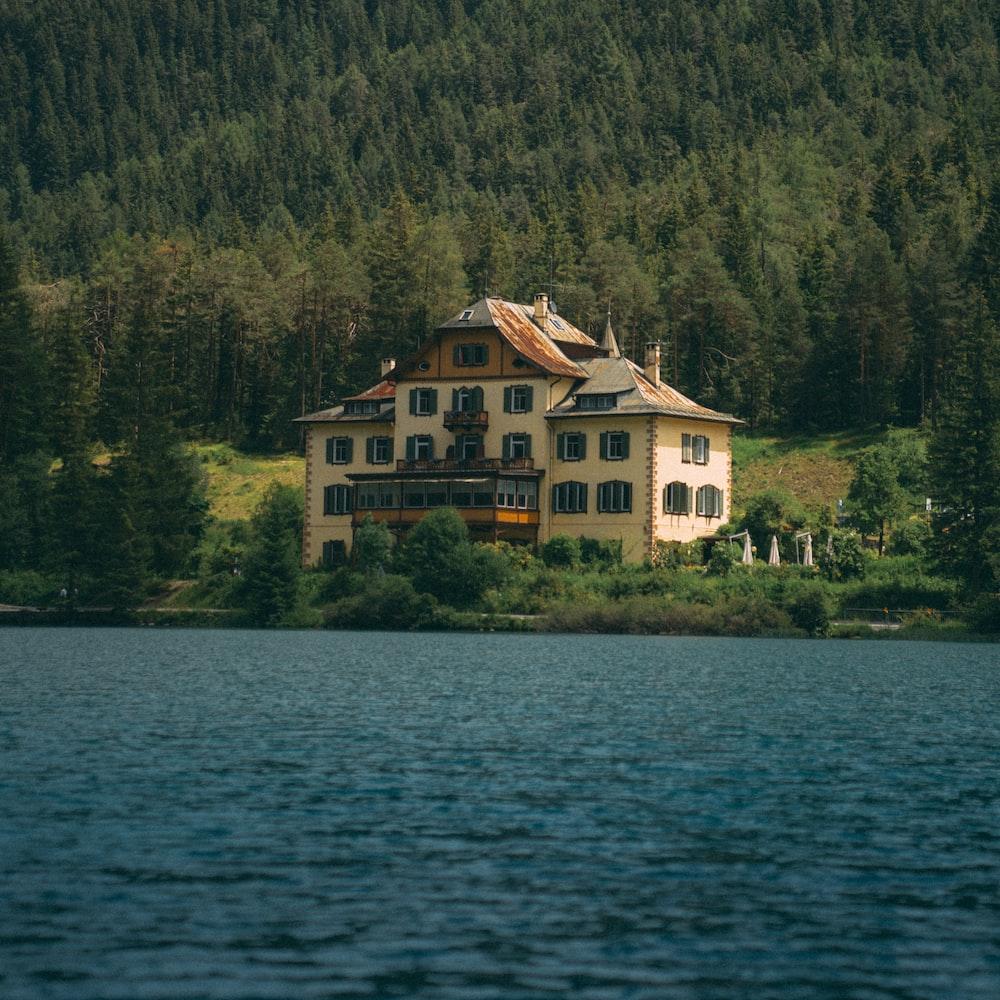 beige house near body of water
