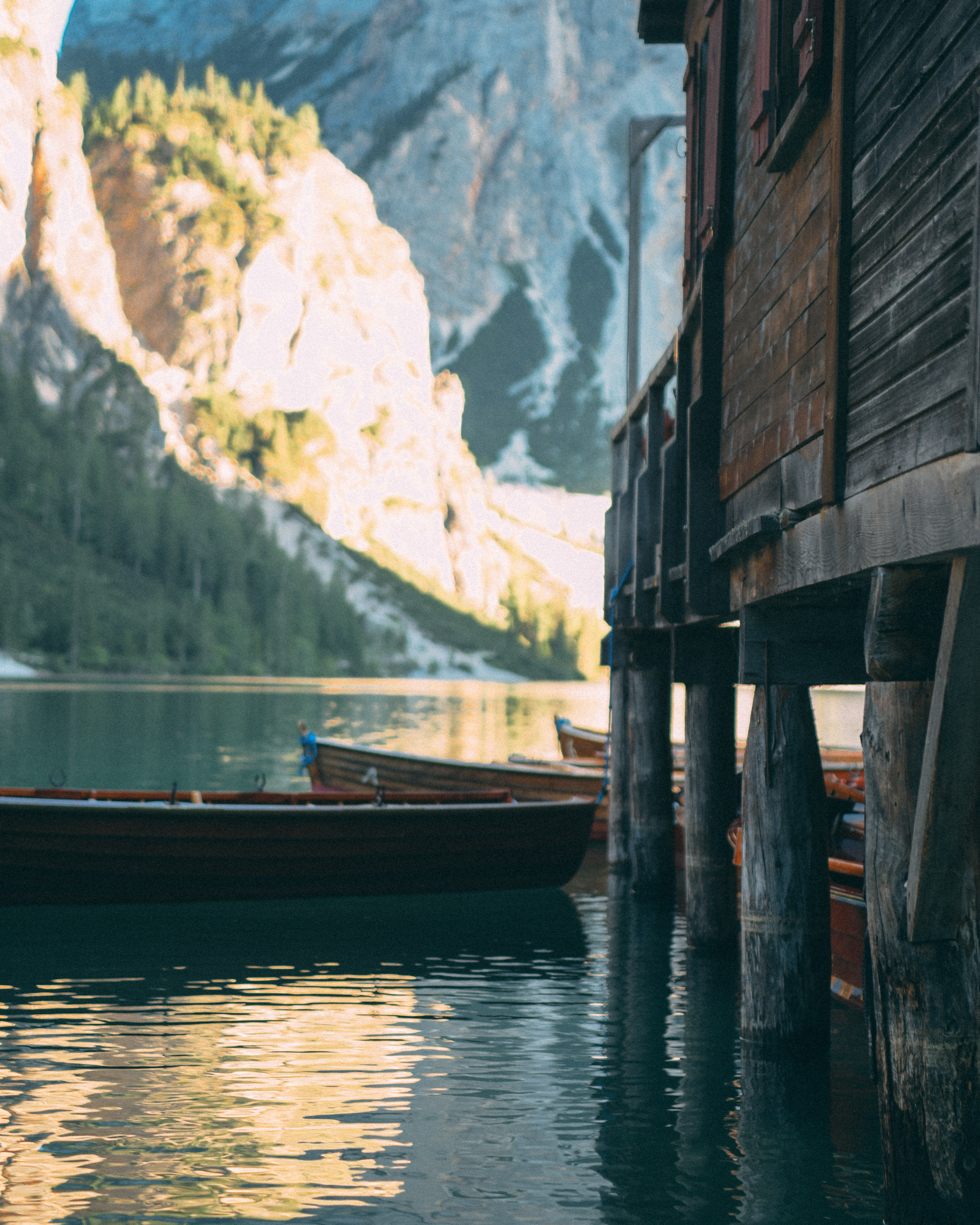 brown wooden boat beside house