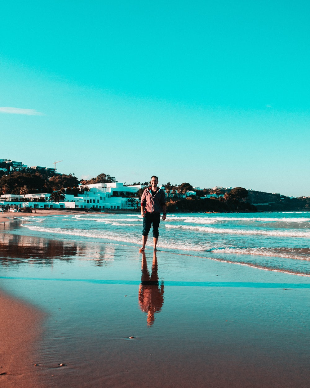 person standing on shoreline