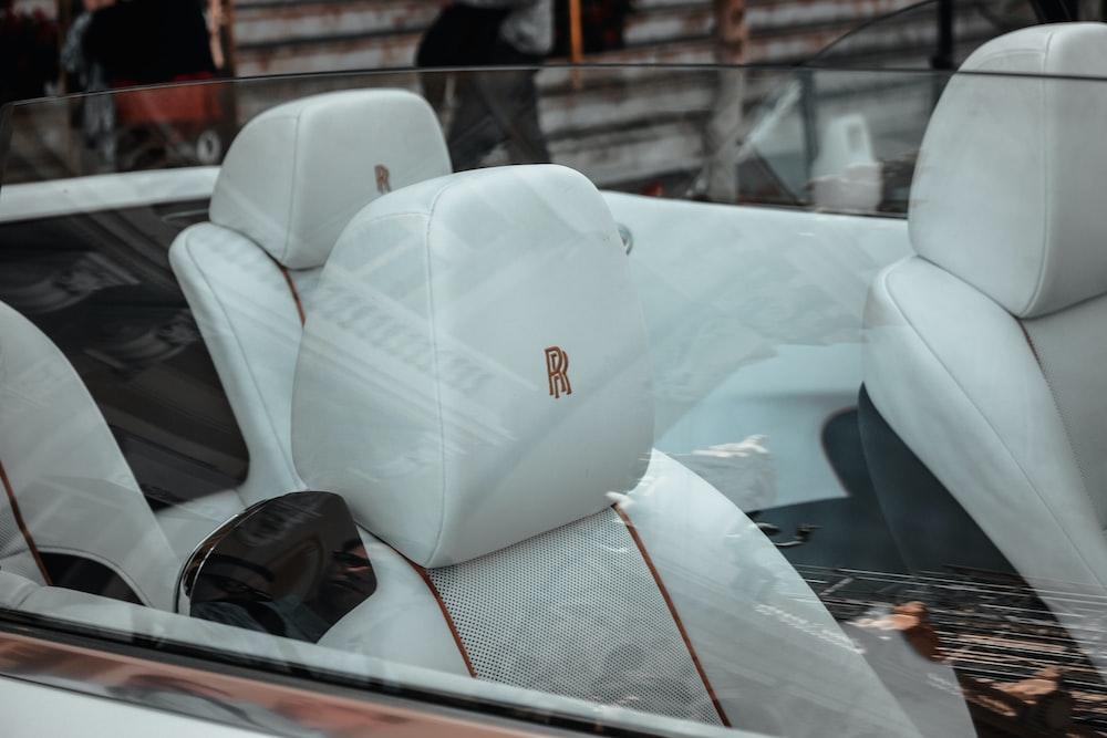 white Rolls-Royce vehicle interior during daytime