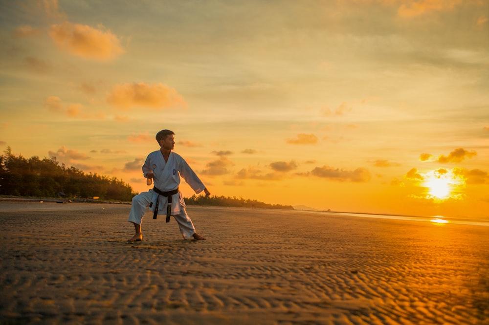 man wearing karate gi near shore