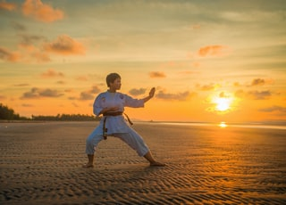 boy doing karate routines during golden hour