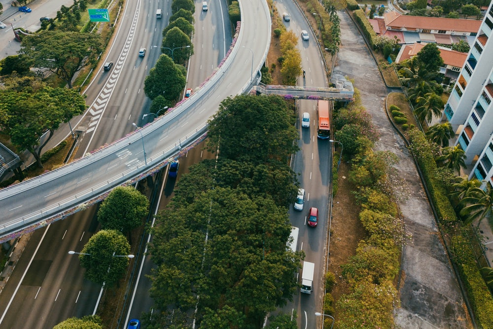 aerial photography of vehicles running on highway