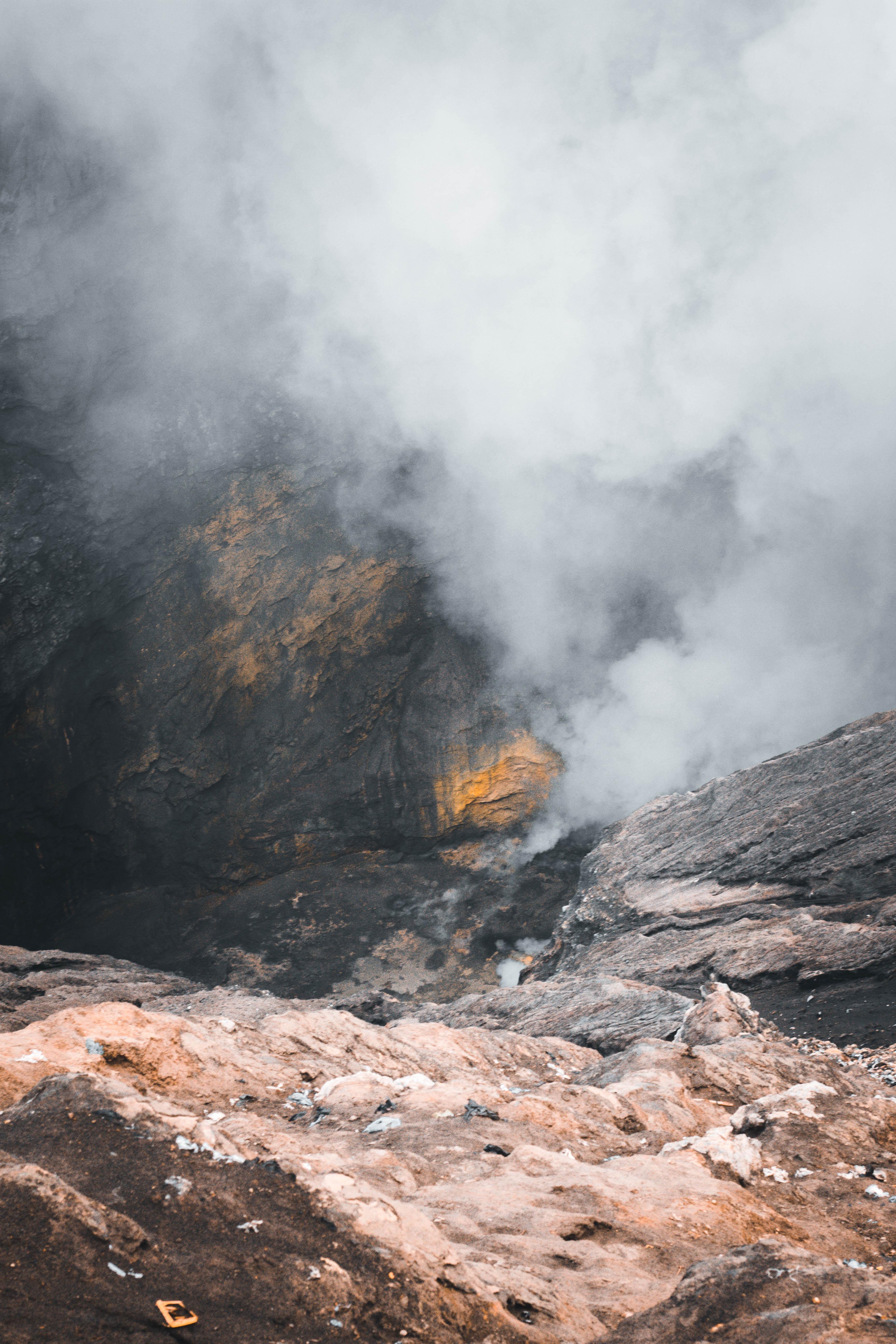 smoke coming from rock mountain