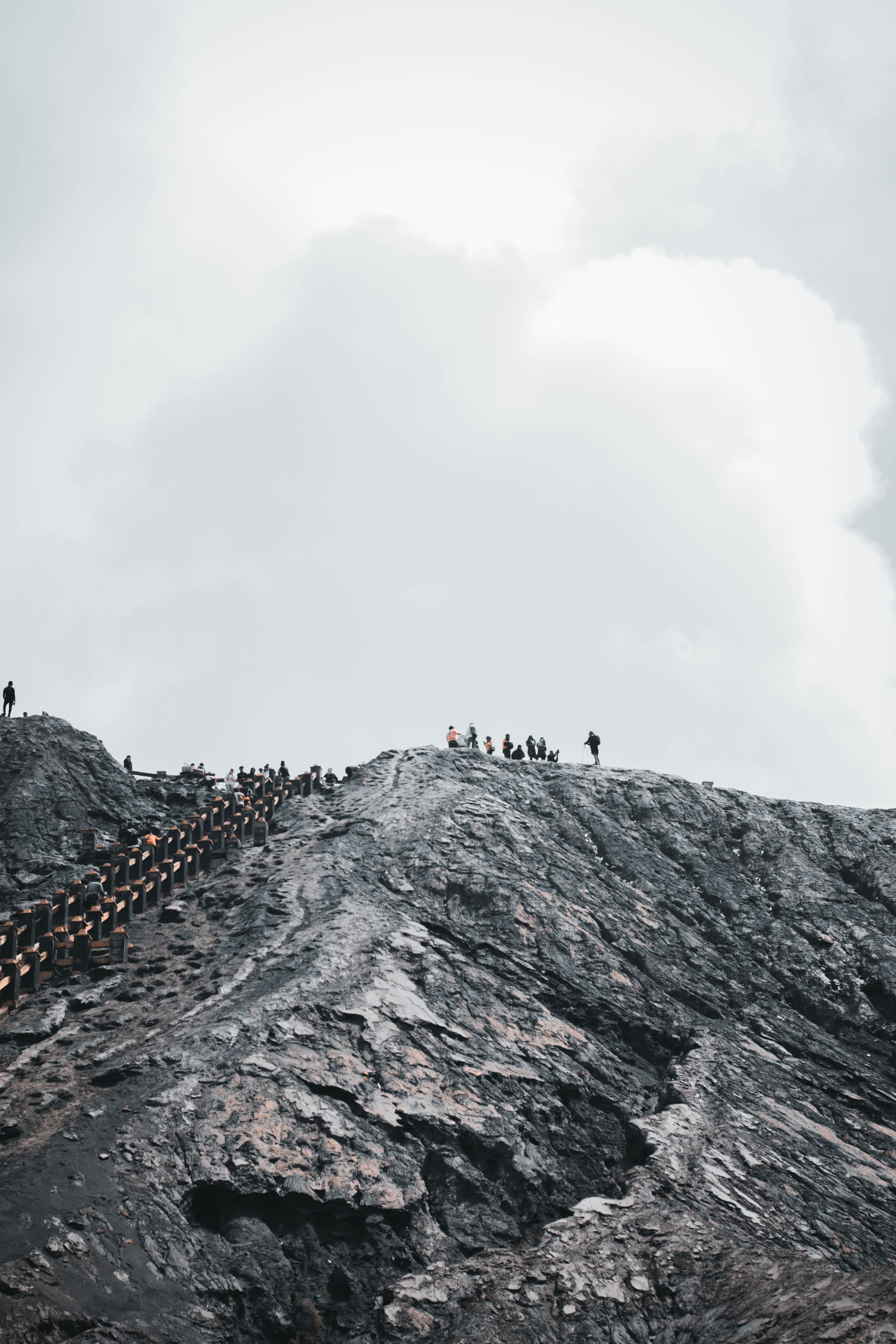 people standing on hill
