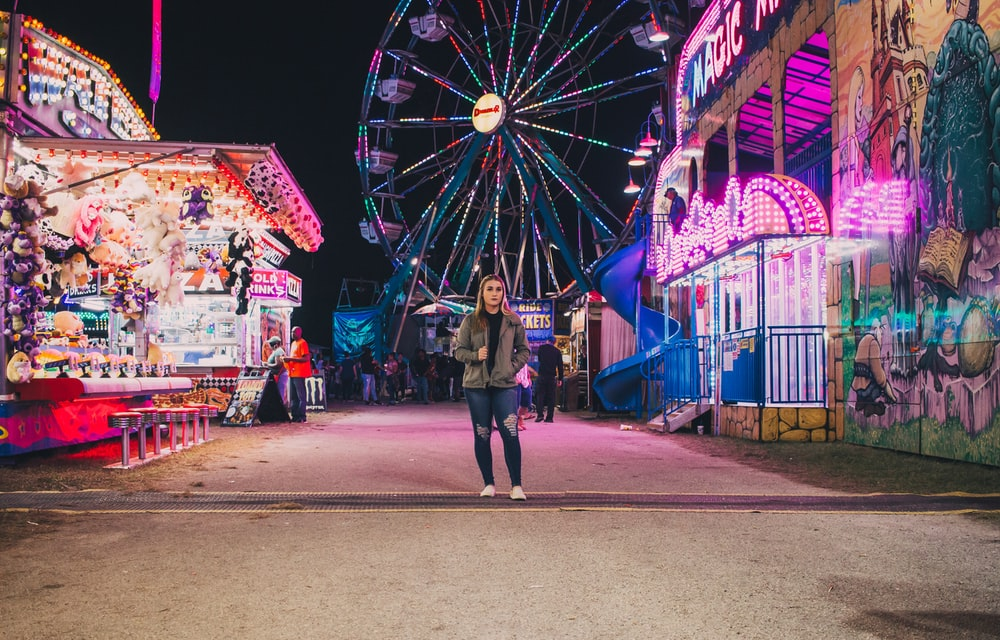 person standing in amusement partk