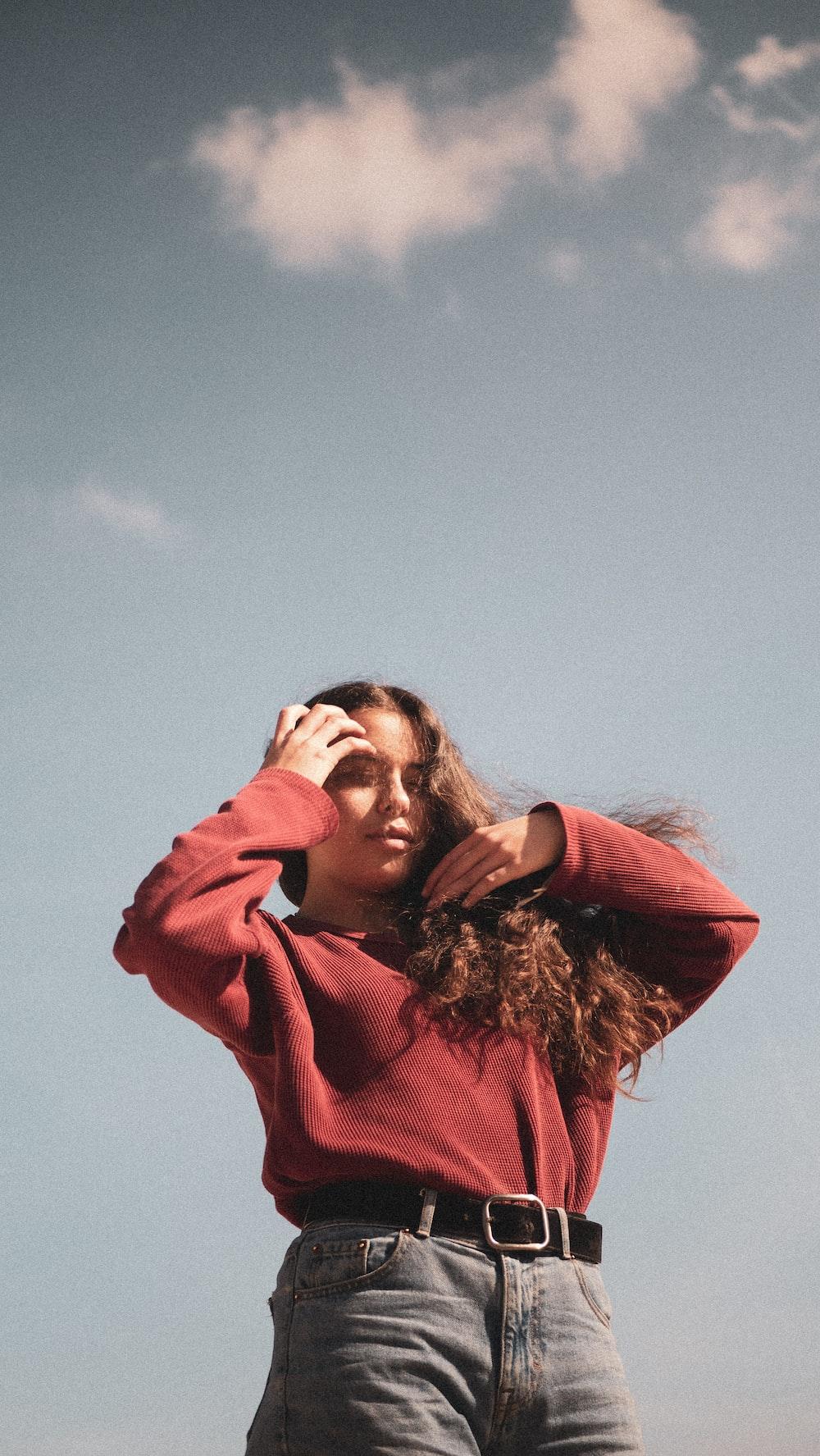 woman wearing maroon sweater