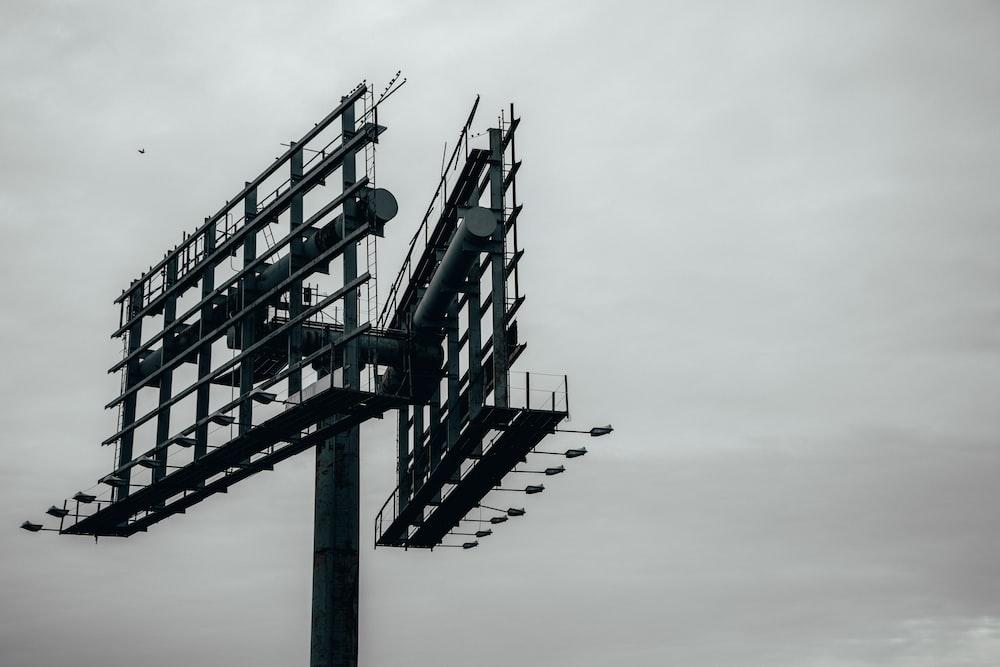 grayscale photography of metal billboard