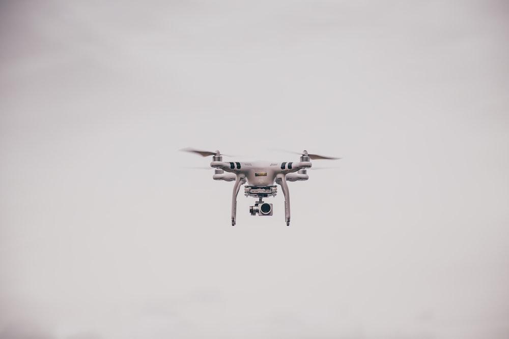 white DJI Phantom drone at mid air