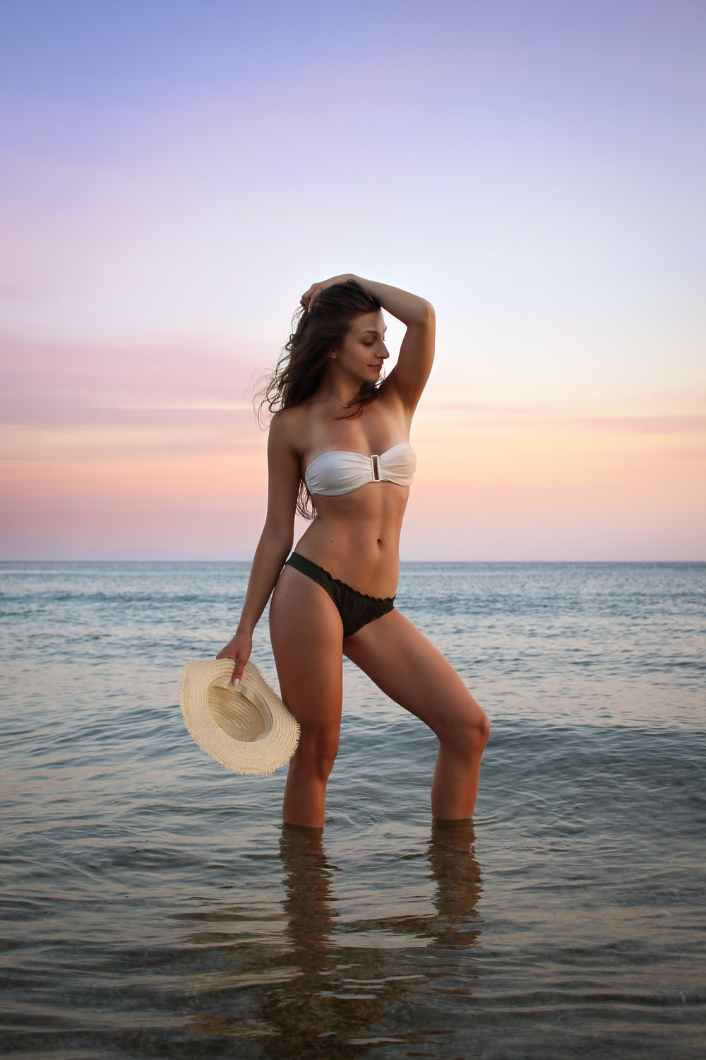 woman in bikini posing on seashore