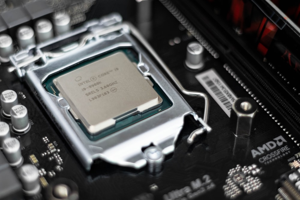 Intel processor on black motherboard