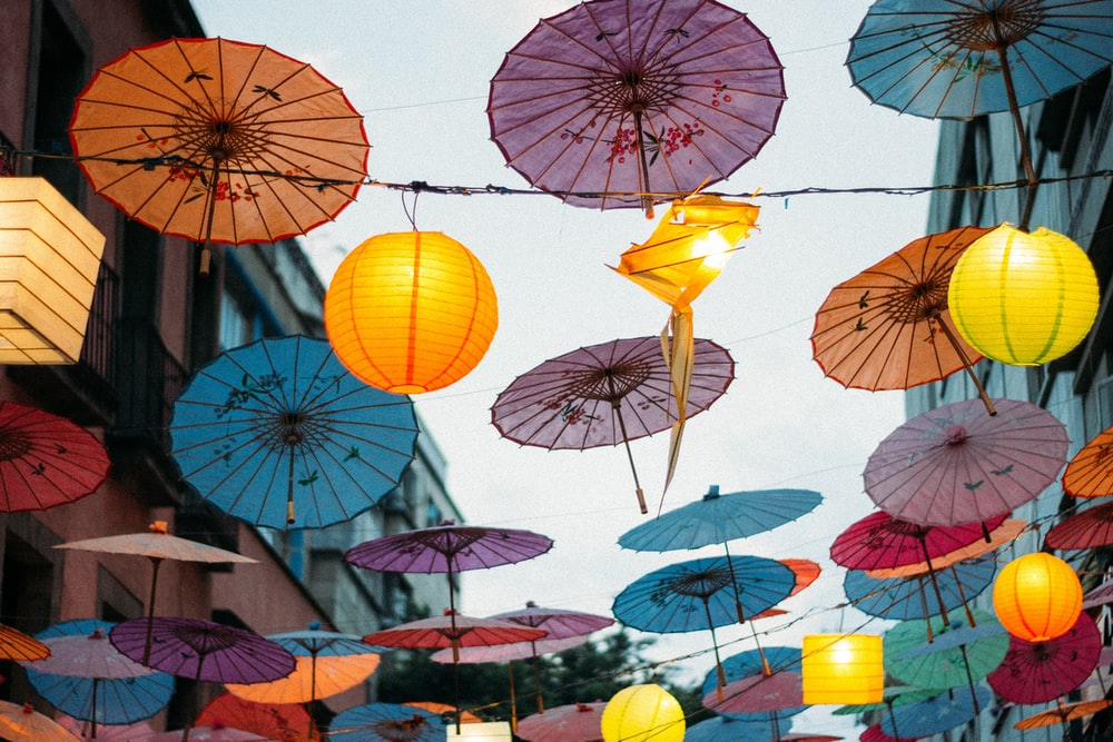 umbrellas hanging on wires