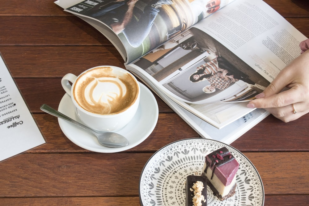 cup of latte near book